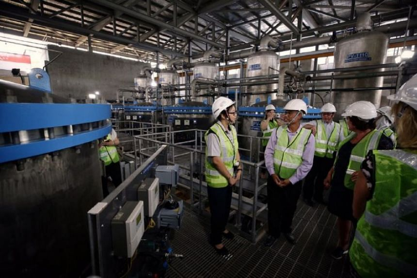 Minister for the Environment and Water Resources Masagos Zulkifli touring the ceramic membrane filtration building in Choa Chu Kang Waterworks on Aug 29, 2019.