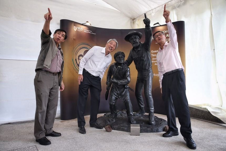 (From left) Head of the Lee Kong Chian Natural History Museum, Professor Peter Ng, Senior Minister and Coordinating Minister for National Security Teo Chee Hean and NUS president Tan Eng Chye at the unveiling of the statues of British naturalist Alfr