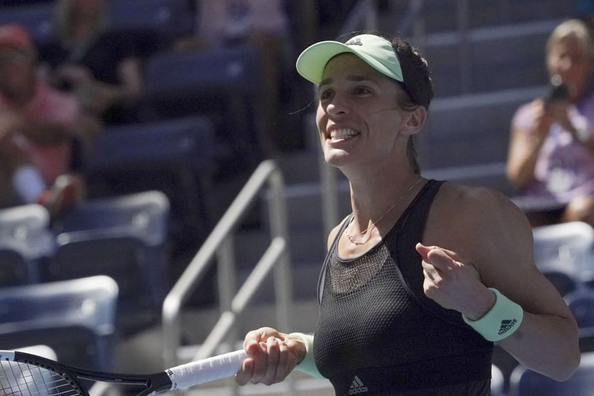 Petkovic reacts after defeating Petra Kvitová of the Czech Republic.
