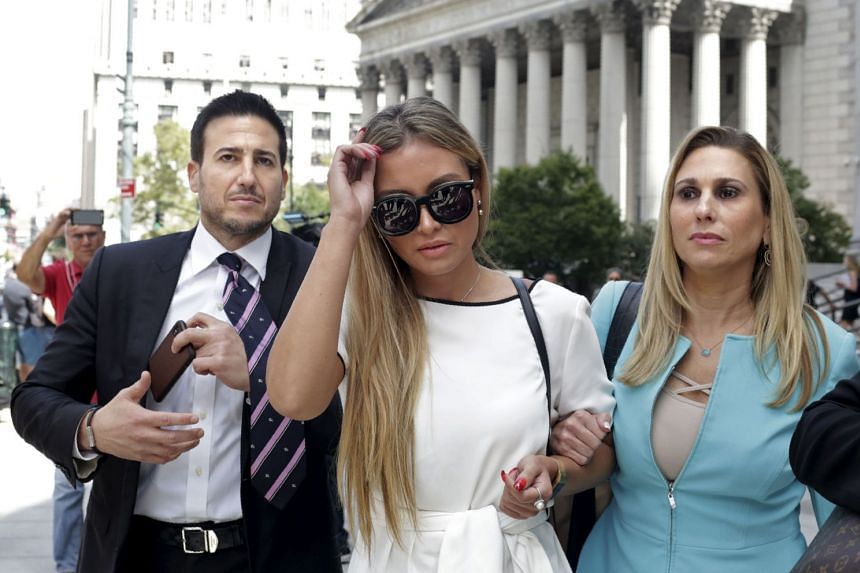 Jennifer Araoz (centre), one of Epstein's alleged victims, and her attorney Kimberly Lerner (right), finish speaking to the press outside the US Federal Court on Aug 27, 2019 in New York.