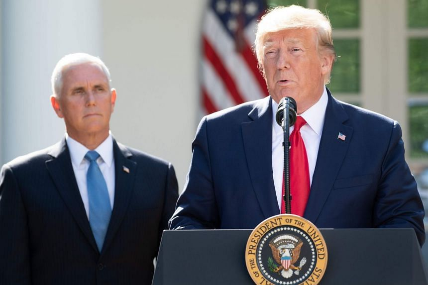 Trump speaks alongside US Vice-President Mike Pence during an event establishing the US Space Command.