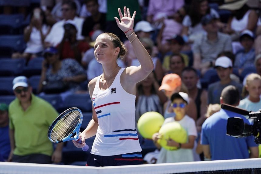 Pliskova reacts after defeating Ons Jabeur of Tunisia.