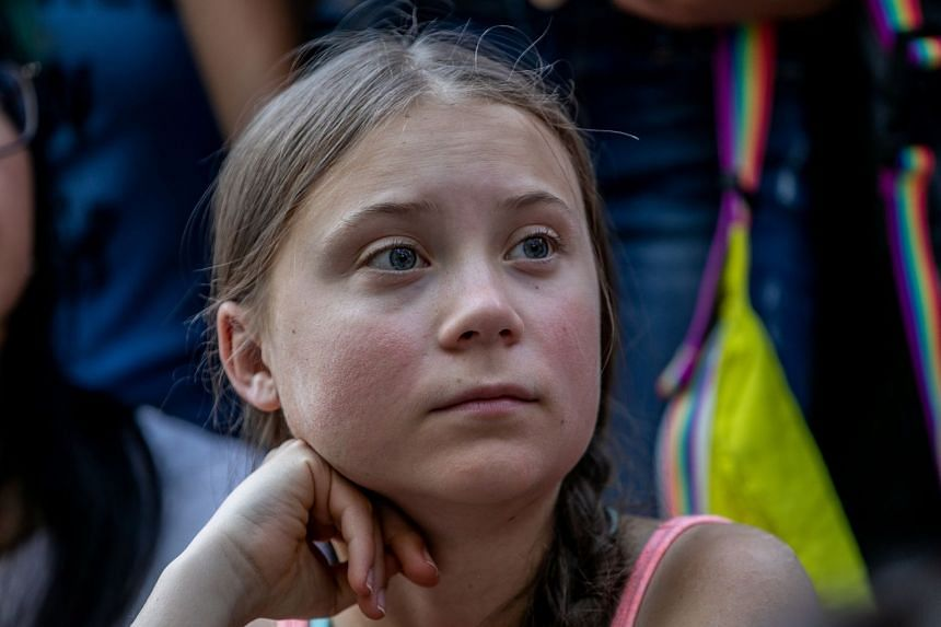 Greta Thunberg participates in a youth climate change protest in front of the UN headquarters in Manhattan.