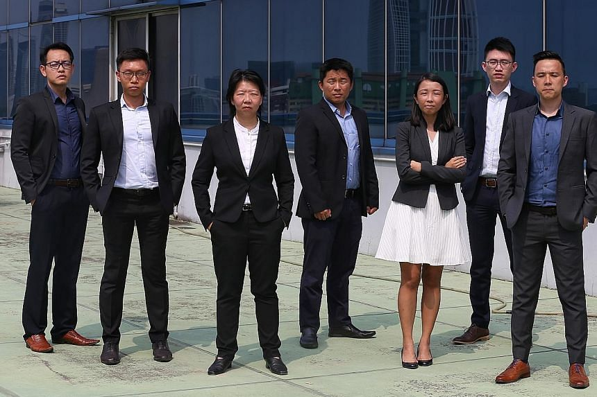 Deputy Assistant Commissioner Aileen Yap (third from left), assistant director of the Specialised Commercial Crime Division in the Commercial Affairs Department, with the team of six officers across various departments in the police who helped set up