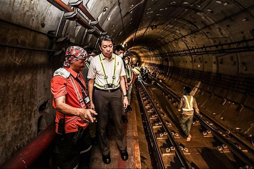 """NTUC assistant secretary-general Melvin Yong (centre) said in a blog post earlier this week that recent losses incurred by rail operators are """"at odds"""" with the objectives of the New Rail Financing Framework."""
