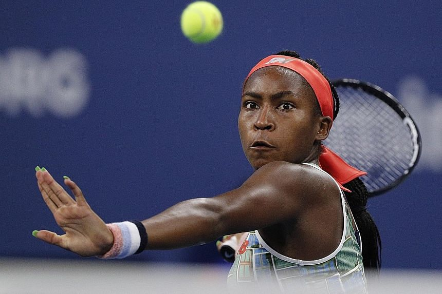 Cori Gauff, backed by a raucous crowd at the Louis Armstrong Stadium, hitting a return to Timea Babos during their third-round match. The 15-year-old will next face Naomi Osaka.
