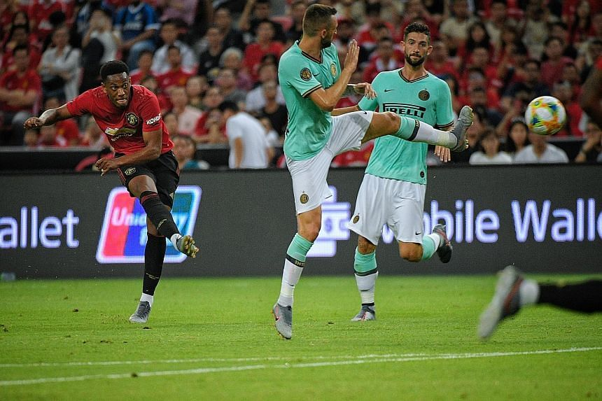 Anthony Martial, taking a shot against Inter Milan in Singapore in July, will bear a heavier striking burden with forwards Alexis Sanchez and Romelu Lukaku leaving for Italy.