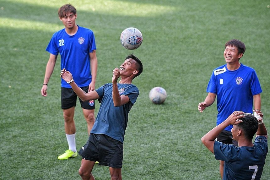 Warriors FC players training at Jurong East Stadium yesterday for their game against defending champions Albirex today. The FAS says club GM Paul Poh should vacate his post.