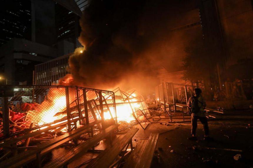 Protesters light a barricade on fire during an anti-government rally in Hong Kong, on Aug 31, 2019.