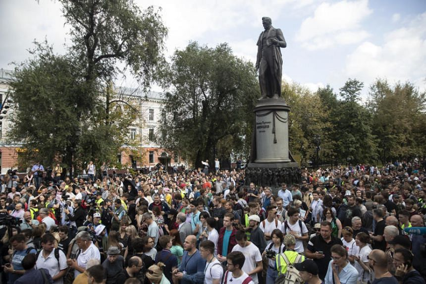 People attending a protest march in Moscow, Russia, with the statue of famous poet Alexander Griboyedov in the background, on Aug 31, 2019.