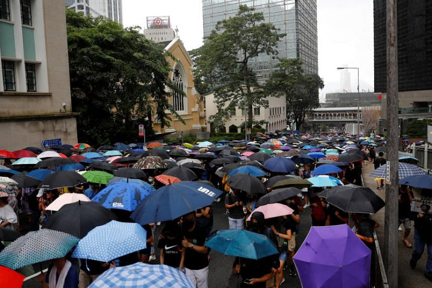 Protesters march in Hong Kong on Aug 31, 2019.