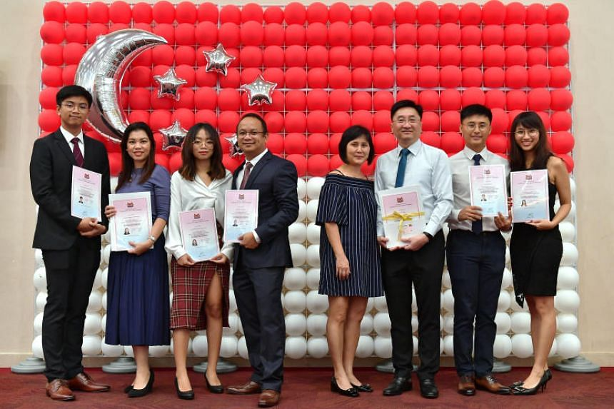 Mr Alvin Paras Dimalanta (fourth from left), his wife Michelle Anne (second from left) and their children Anne and Allen with their citizenship certificates at the annual National Citizenship Ceremony on Aug 31, 2019. Also at the ceremony were the La