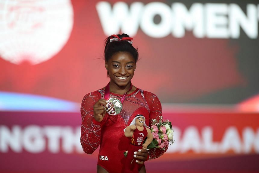 Biles poses with her medal at the 2018 FIG Artistic Gymnastics Championships in Doha in 2018.