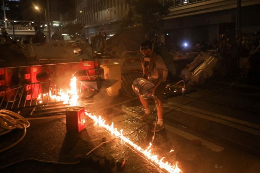 A protester lights a barricade on fire in Hong Kong on Aug 31, 2019.