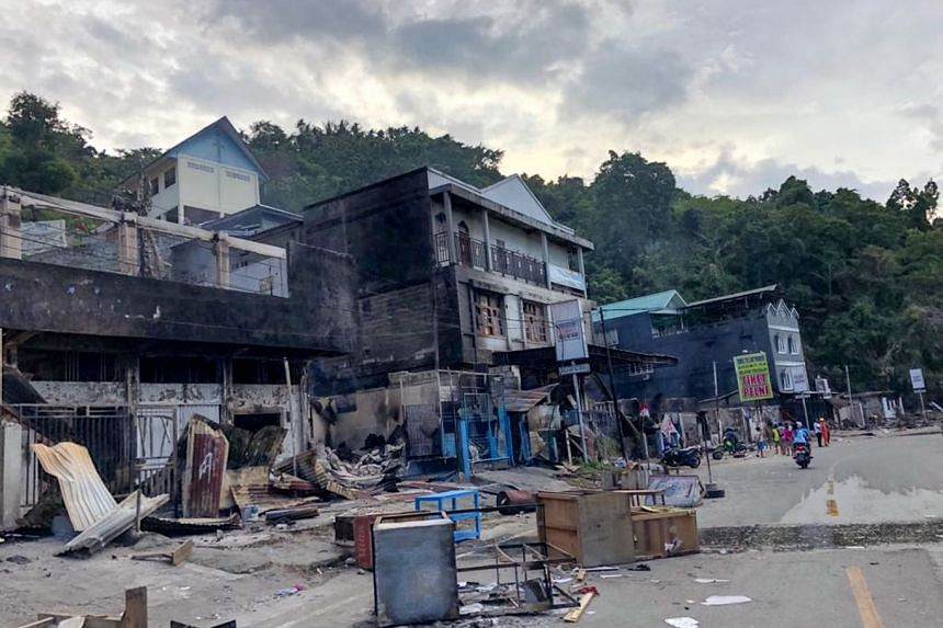 Torched shops in Jayapura on Aug 30, 2019.
