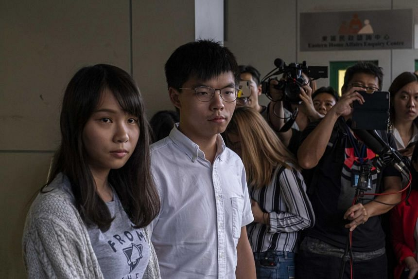 Activists Agnes Chow and Joshua Wong speak to reporters after being arrested by the police and released on bail in Hong Kong on Aug 30, 2019.