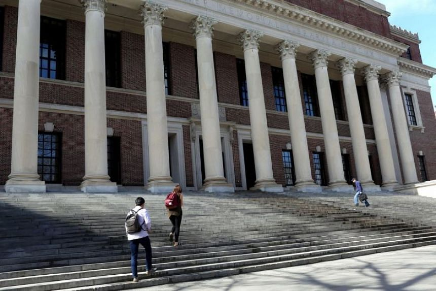 Students walking up the steps of Widener Library, on the Harvard University campus in Cambridge, Massachusetts, on May 1, 2018. Colleges and universities have found themselves in the crossfire of US President Donald Trump administration's aggressive