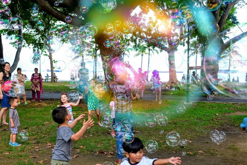 Indonesian domestic worker Ana Rohana's photo of children playing with bubbles (above) and Bangladeshi worker Islam Mohammad Saiful's picture of his lunch are among the 12 photos shortlisted for the Migrant Workers Photography Festival.
