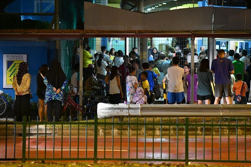 Parents waiting for their children outside Punggol Primary School on Aug 30, 2019
