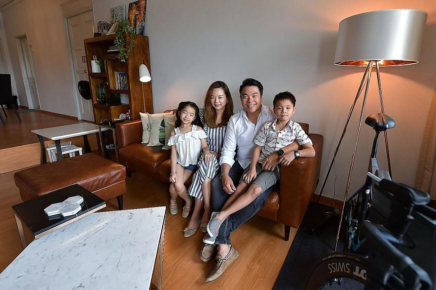 Mr Gerald Tan, 37, with his wife Bernice Ong, 36, son Gabriel, eight, and daughter Elizabeth, six, in their home, a three-bedroom apartment which was bought in 2009 for $1.65 million. Mr Tan chose this apartment, comfortably sized at 1,614 sq ft, because