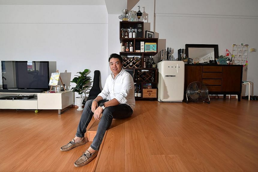 Mr Tan relaxing in his 1,614 sq ft condo unit. He bought the apartment in 2009 but rented it out from 2011 until he moved back this year.