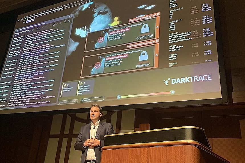 Darktrace's director of technology Dave Palmer speaking on Aug 5 at the Gartner Security and Risk Management Summit in Tokyo.