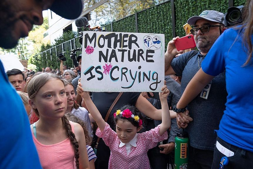 Swedish climate change campaigner Greta Thunberg (second from left in picture) joined hundreds of other teenagers protesting outside the United Nations last Friday in her first demonstration on US soil since arriving by zero-carbon yacht. Greta, 16,