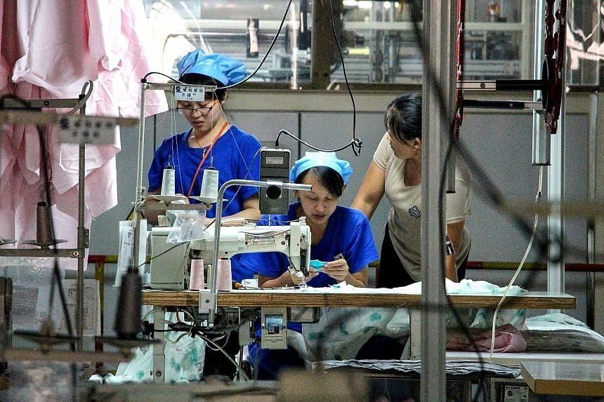 Shoppers at a mall in Pennsylvania, in the US. American retailers may do all they can to avoid raising prices during the back-to-school and holiday shopping season. But they will have no choice if tariffs continue to rise. Chinese factory workers in