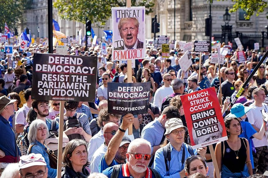Demonstrators outside Prime Minister Boris Johnson's office in Downing Street yesterday protesting against the move to suspend Parliament in the final weeks before Brexit.