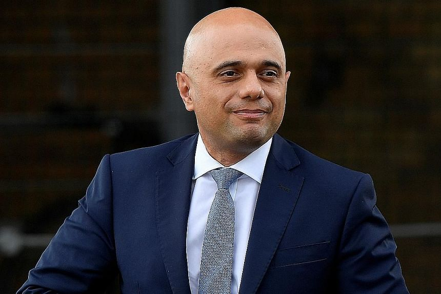 "Finance Minister Sajid Javid (left) was reportedly ""livid"" about the firing of his press aide by the top adviser to Prime Minister Boris Johnson. PHOTO: REUTERS"