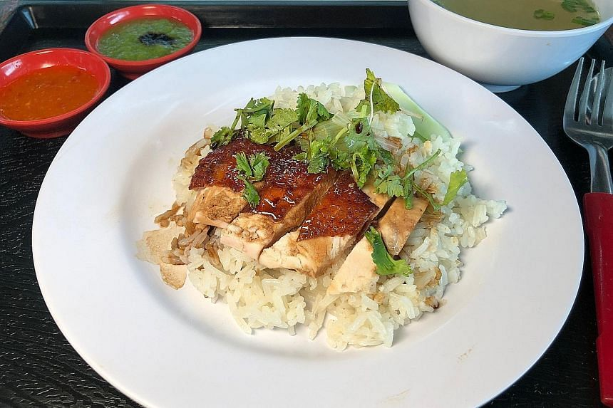This $1.50 plate of chicken rice comes with a decent amount of rice, four slices of breast meat, cucumber, coriander and a bowl of soup.