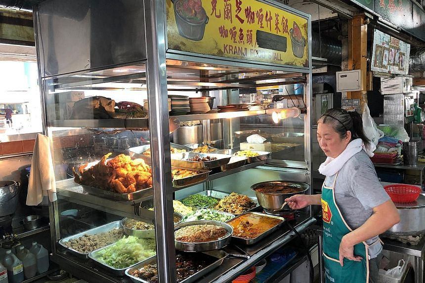 At Kranji Food Stall operated by Madam Wendy Koh (above), a plate of rice with a fried chicken drumstick and two vegetable dishes costs $3.30.