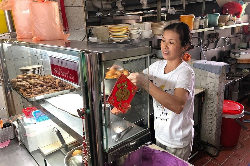 To make her pig's organ soup, stall owner Yang Yue Ying (above) marinates the pork liver and pork slices in tapioca starch.