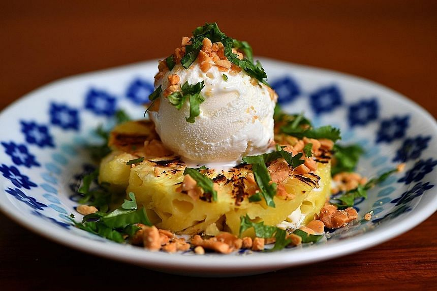 Make this peanut-coriander sundae (left) with juicy, charred pineapple topped with coconut ice cream. The peanut-coriander noodle salad (above) is built on a base of shirataki noodles with plenty of crunchy vegetables.