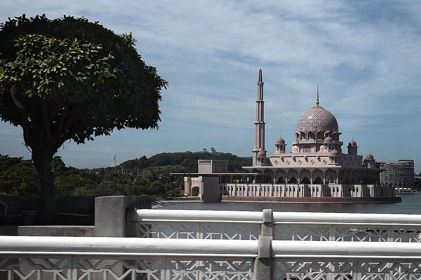 The Putra Mosque in Malaysia's administrative capital, Putrajaya. The city is home to dome-topped buildings, man-made lakes and broad avenues. While critics once called Putrajaya a waste of money, many of its 88,000 residents - most of whom are civil