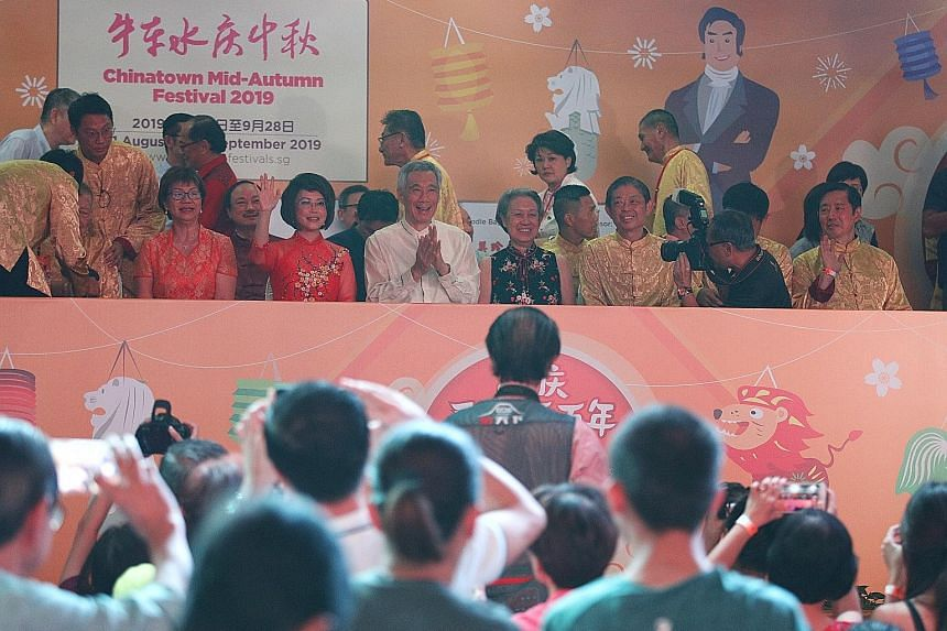 The opening ceremony of the Chinatown Mid-Autumn Festival kicked off with a bang yesterday, with Prime Minister Lee Hsien Loong as its guest of honour, who was there with his wife. Performers at the opening ceremony, held in front of the Lucky Chinat