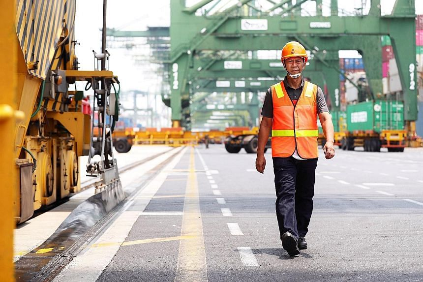Crane operator Suliman Basri has worked for port operator PSA for the last 31 years, mostly at Brani Terminal on Pulau Brani. He has offered to work at Tuas Terminal when Brani operations eventually move there.