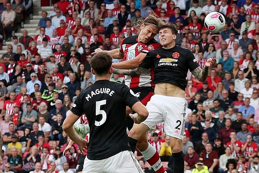 Southampton's 1.99m Jannik Vestergaard towering above Manchester United's Victor Lindelof to equalise in their 1-1 draw at St Mary's Stadium yesterday. It was the defender's first goal for his club. PHOTO: REUTERS