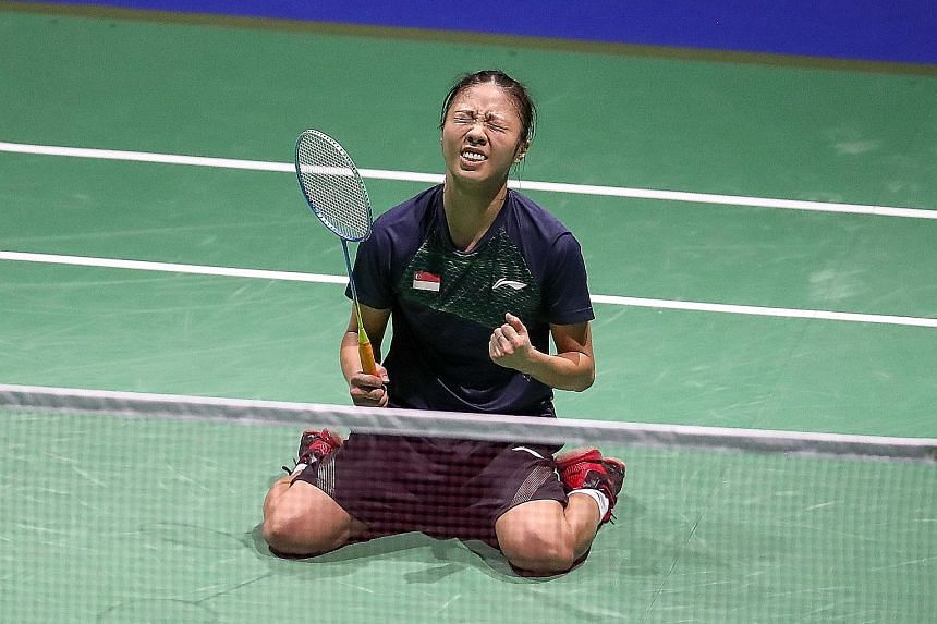 Left: A relaxed Yeo Jia Min at home. Among her areas for improvement are footwork and mental strength. ST PHOTO: GIN TAY Below: The ecstatic shuttler on her knees after stunning world No. 1 Akane Yamaguchi at the World Championships in Basel. PHOTO: