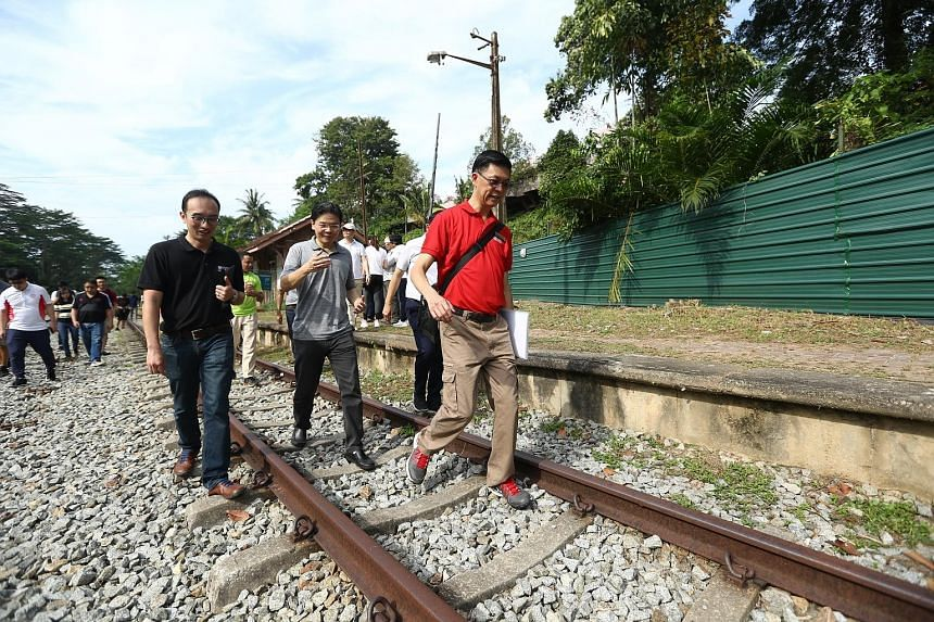 (From left) Architectural historian and conservator Yeo Kang Shua, National Development Minister Lawrence Wong and the Urban Redevelopment Authority's director of projects Teo Chong Yean at the Bukit Timah Railway Station yesterday.