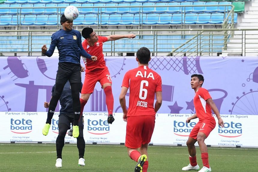 In this photo taken on March 31, national striker Fazrul Nawaz (in blue) engages in an aerial duel with Young Lions defender Lionel Tan during the match between Hougang United and the Young Lions.