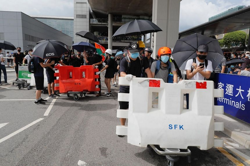 Pro-democracy protesters prepare blockades outside the Hong Kong airport on Sept 1, 2019.