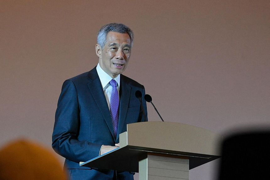 "In a photo taken on Nov 7, 2018, Prime Minister Lee Hsien Loong delivers a speech at the International Conference Singapore 2018.  PM Lee has asked Mr Xu to remove the article and post immediately and publish a ""full and unconditional"" apology by Sep"