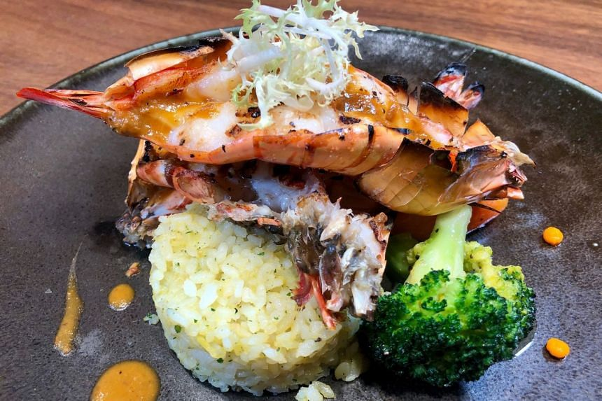 3. GRILLED KING PRAWNS WITH DURIAN BUTTER RICE.