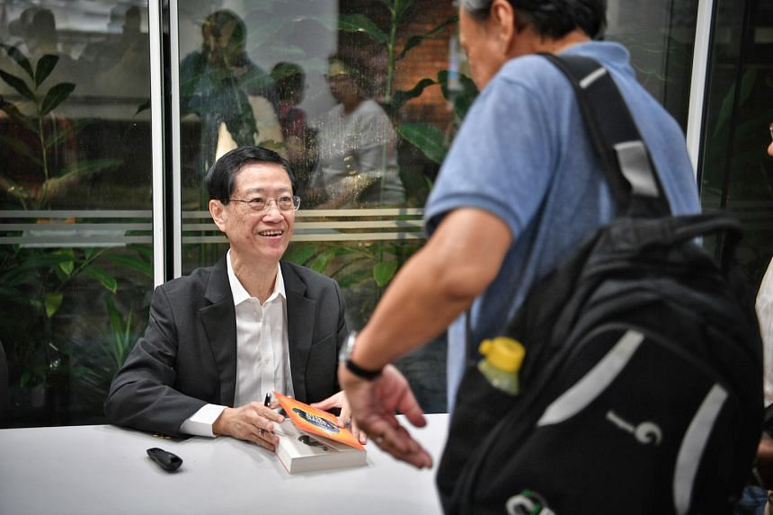 """Author Soo Kok Leng signing his book, Think Wits Wins: How To Use Sun Zi's Art Of War For Success, at The Straits Times Book Club session at National Library. He says that in an enterprise, the leader's Dao - """"The Way of Moral Authority"""" - is manifes"""