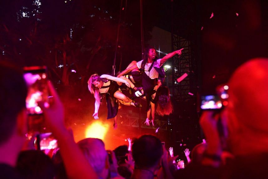 This photo, taken on Aug 31, 2019, shows performers soaring through the confetti-filled air, during a show by globally-acclaimed Argentinean troupe Fuerza Bruta, at the Singapore Night Festival.