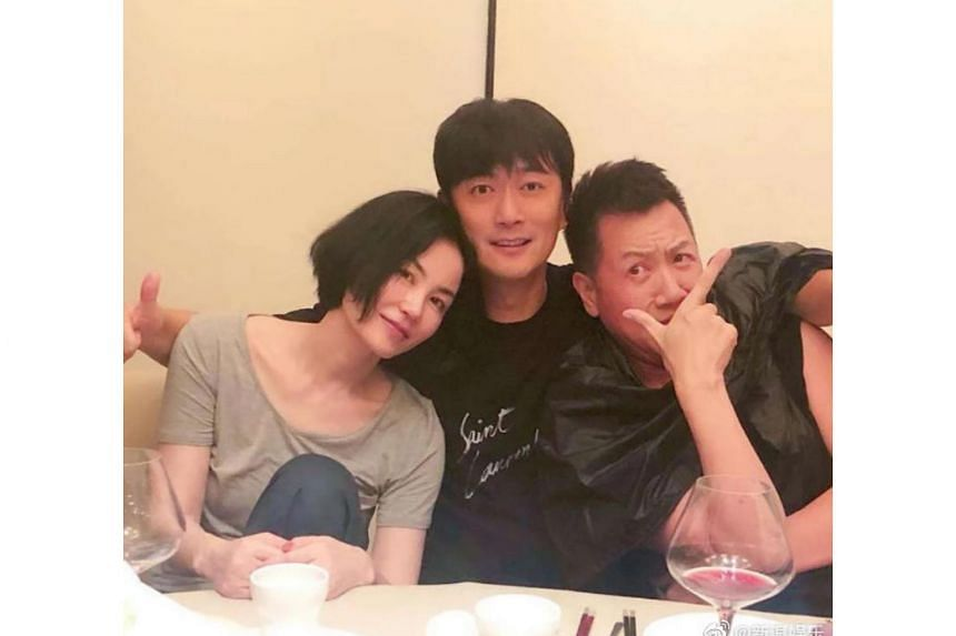 While a photo posted on Aug 8 showed Faye Wong with other men, there was no sign of Nicholas Tse who was reportedly held up with work in Shanghai.