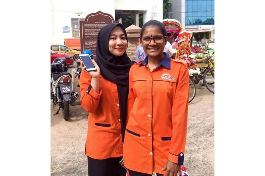 Malaysian student Nuramira Hasan with her friend Divya in a photo tweeted last Monday, accompanied by a message asking other Twitter users to share pictures taken with friends of different races.