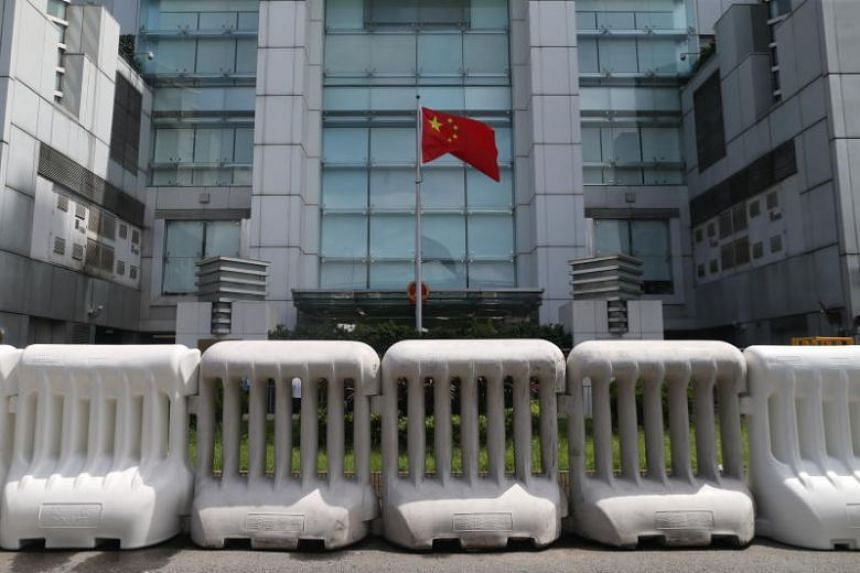 The Chinese flag fluttering behind barriers outside the China Liaison Office in Hong Kong on Aug 31, 2019.
