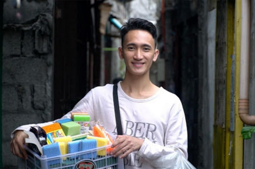 """Mr Melvin Chua, also known as """"sponge boy"""", used to walk the streets of Pembo in Manila for more than six hours every day selling dish sponges and dish cleaners to support his family."""